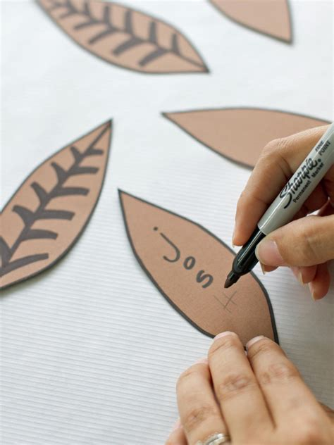 How To Make Feathers Out Of Construction Paper - thanksgiving place card and favor hgtv