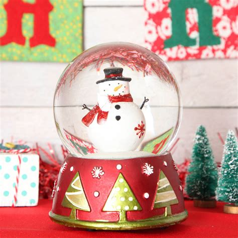musical snowman snow globe snowman large musical snow globe dome by berry apple notonthehighstreet