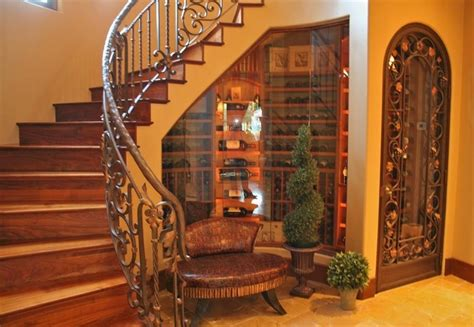 love glassed in wine cellar under stairs with decorative door california dreamin if i win