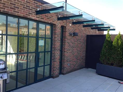 Simple Awning Design Puck Building Glass Canopy 183 Bellwether Design Technologies
