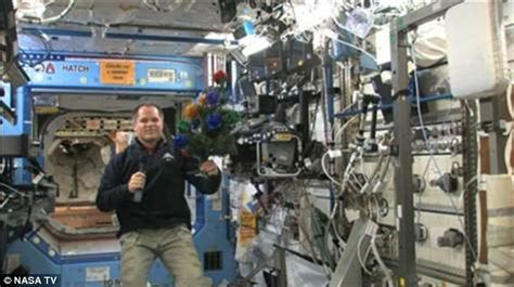 small crew  astronauts celebrate merry christmas  international space station daily mail