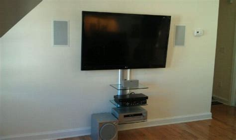 in wall speakers tv on wall shelf cable box dvd player