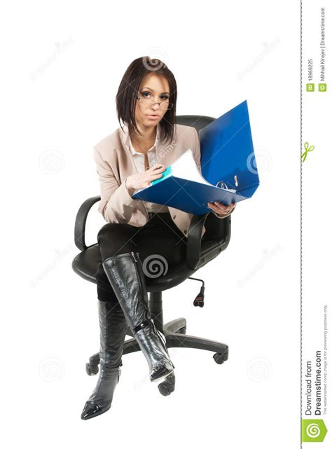 woman in an armchair a young woman sitting in an office armchair royalty free