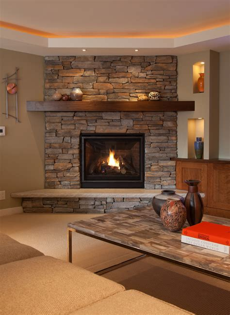room fireplace stone corner fireplace family room rustic with ceiling fan