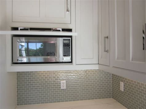 kitchen cabinet microwave built in microwave hidden behind drop down door kitchens