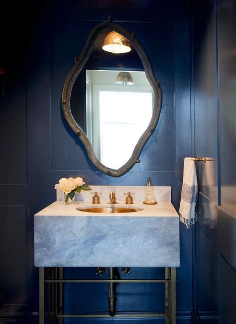 blue powder room navy blue powder room with marble vanity and gold sink