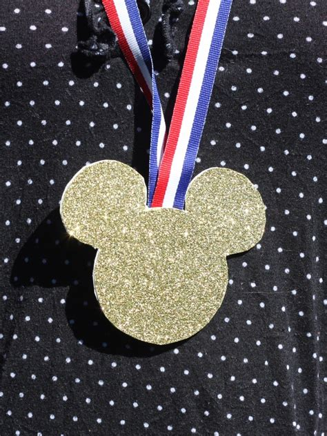 a medal with mouse ears one s journey to running the walt disney world marathon books celebrate sportsmanship with mickey medals this