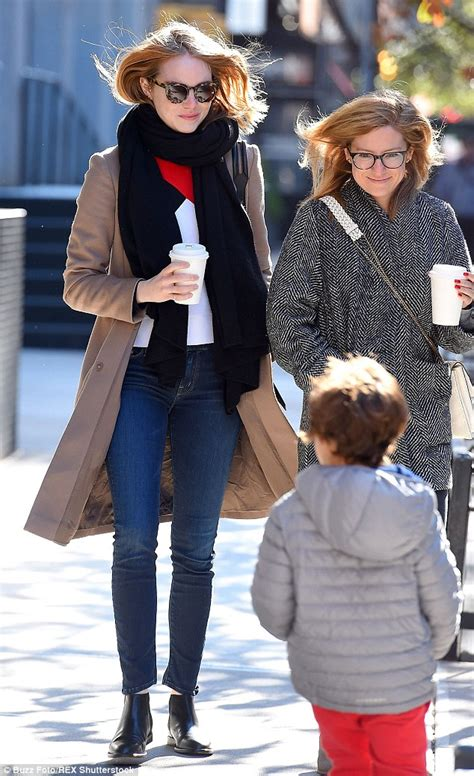 Emma Stone Daily Mail | emma stone in stylish long coat and scarf as she grabs