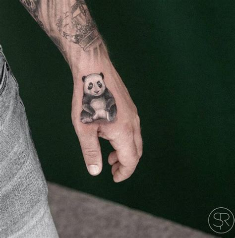 incredible small panda tattoo on hand by sven rayen