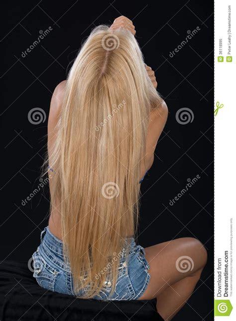 Long Hait Back Shot   stunning blonde haired model in the studio royalty free