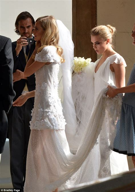 cara delevingne chooses sister poppy s wedding to unveil