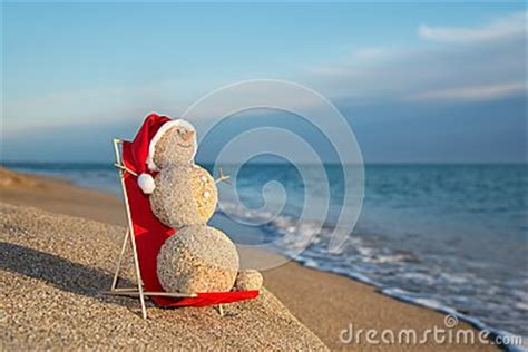 sandy snowman sunbathing  beach lounge holiday concept  ne royalty  stock images
