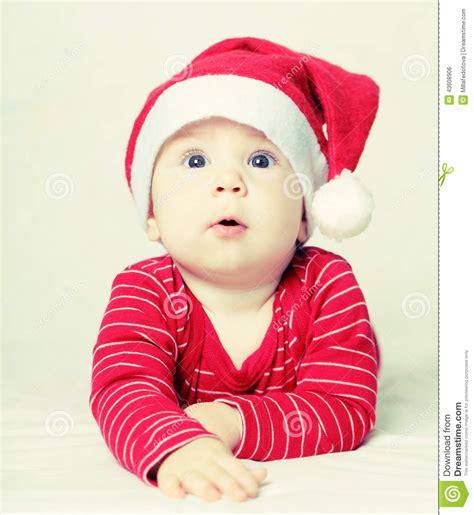 happy baby new year happy new year baby in santa hat stock photo