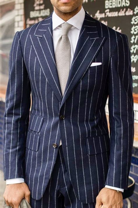 navy blue  white pinstripe suit  silver grey tie