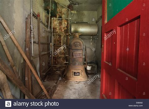 old hot water boiler old boiler in storage room to heat water for the former