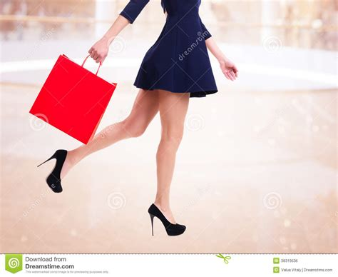 high heels shopping in high heels with shopping bag stock photo