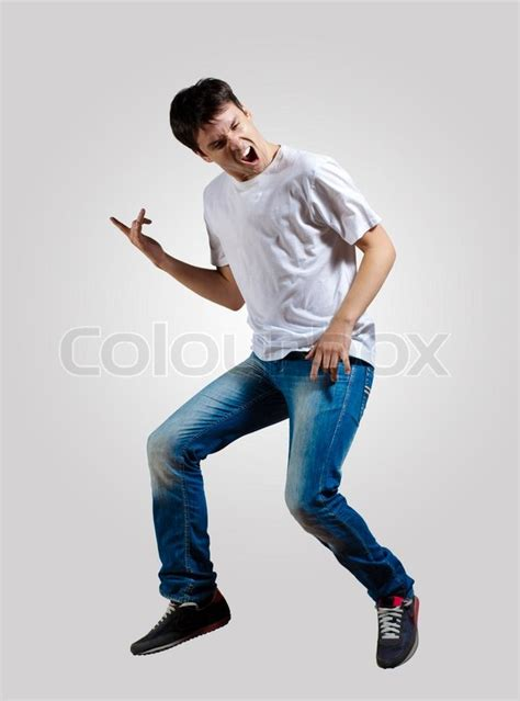 how to dance for your man in the bedroom young man dancing and jumping stock photo colourbox