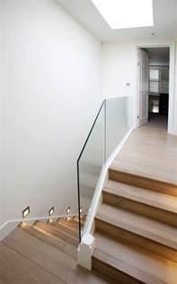 glass landing banister parsons green terraced house minimal modern stair