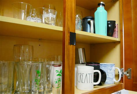 kitchen cabinet door magnets use this hack to keep your cabinet doors shut cnet