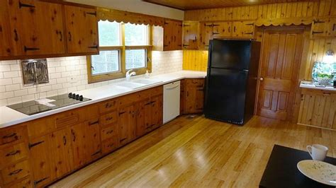 knotty pine kitchen updated  solid surface white