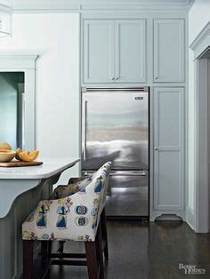 off white cabinetry paired with a glossy neutral tile off white cabinetry paired with a glossy neutral tile