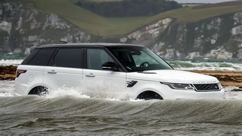 land rover water 2018 range rover sport takes on swimmers in water