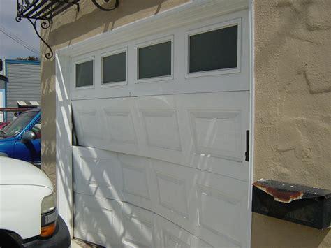 how to repair garage door how to replace broken garage door garage door