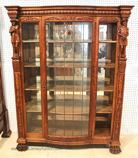 antique quartersawn oak bow front leaded glass china cabinet
