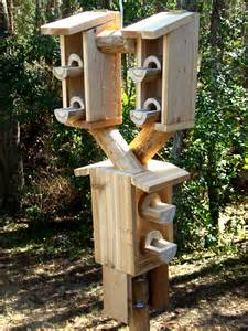 bird feeders on a pole pole mounted bird feeders