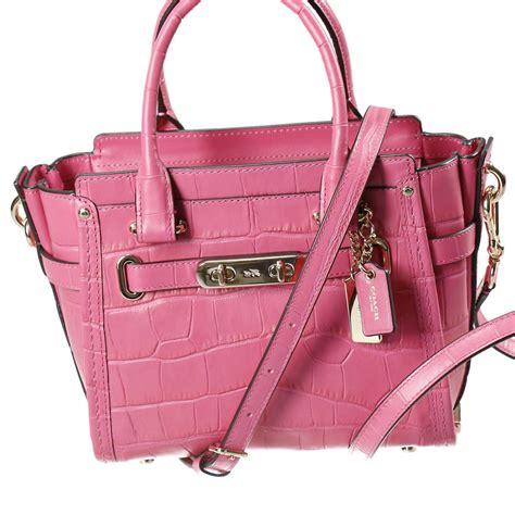 Coach Seagger Mini 902 coach borsa mini swagger piccola 2 manici pelle sta cocco con lock in pink lyst