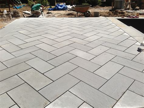 island pool bluestone patio installation step by