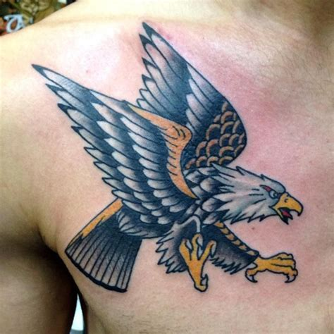 eagle tattoo meaning christian flying eagle tattoo with yellow and grey ink on front shoulder