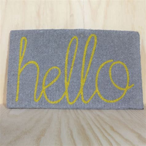 Hello Doormat hello doormat in grey with yellow hello there s no place like home