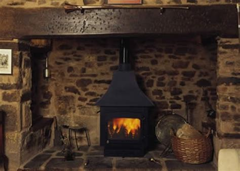 woodwarm with canopy in a traditional fireplace wood
