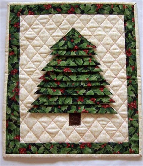 handmade folded winter christmas tree from holly fabric