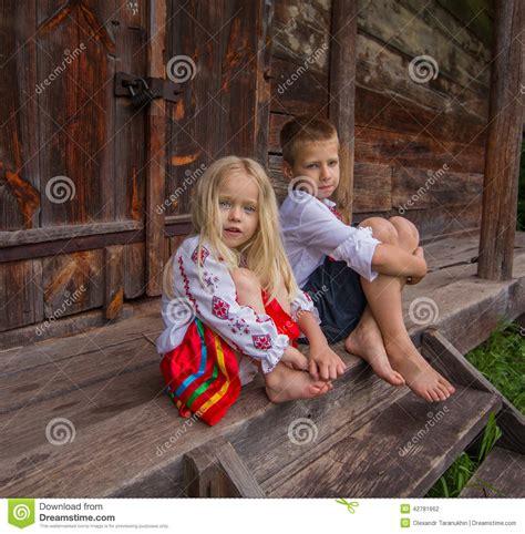 ukrainian children   wooden house stock photo