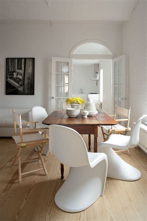 a white dining table matches any theme in your dining room how to mix and match your dining table and chairs photos
