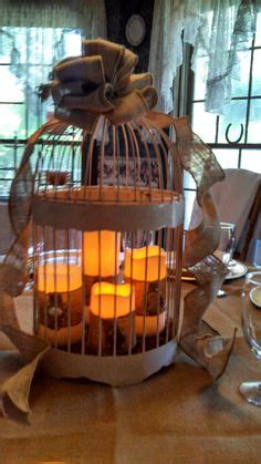 cheap bird cages for centerpieces 1000 images about wedding decorations blue and orange