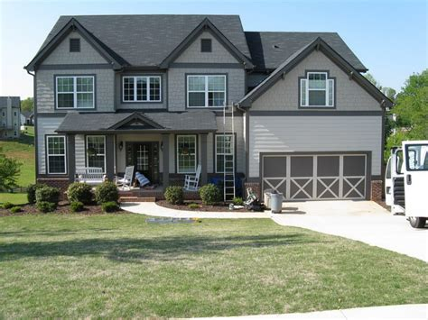 grey house paint dark gray trim light gray siding home project ideas