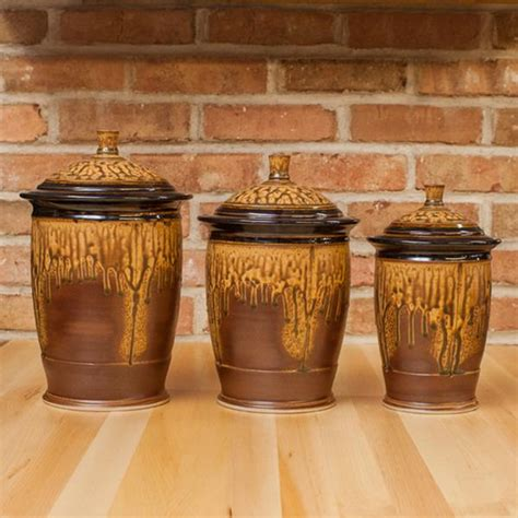 three canister set in brown ash black glaze