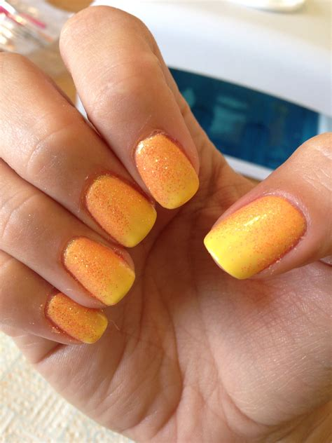 Bicycle Nail shellac cnd bicycle yellow nails with orange neon glitter