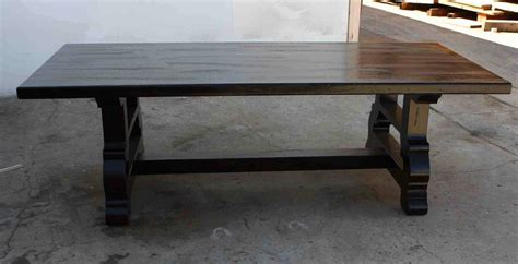 handmade trestle dining table in reclaimed wood by