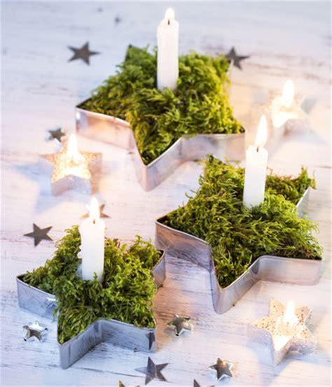 candele decorate per natale via libera al muschio donna moderna