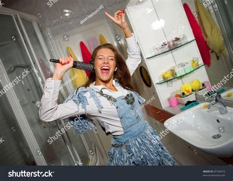 girl singing in bathroom teen girl singing in the bathroom stock photo 62109673