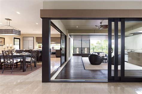 l post l indoor chocolate timber stacker doors to alfresco to match