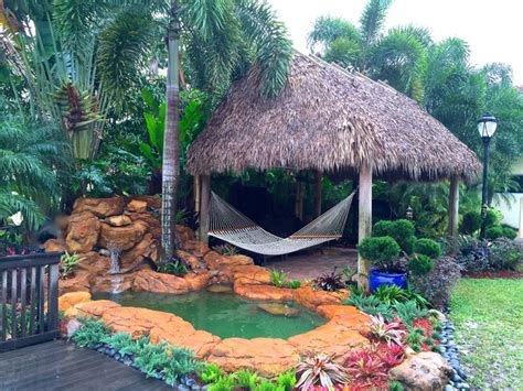 Tropical Tiki Hut tiki hut and waterfall tropical landscape miami by bamboo landscaping and services inc
