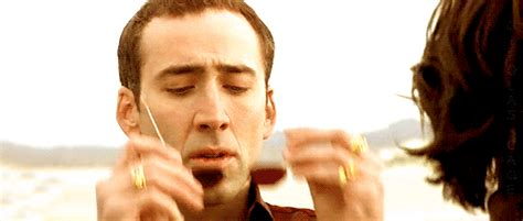 Puts On Glasses Meme - the 20 awesomest nicolas cage gifs heavy com