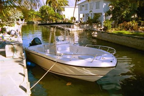 bump jump boat rentals angler 230 center console rental boat docked in florida
