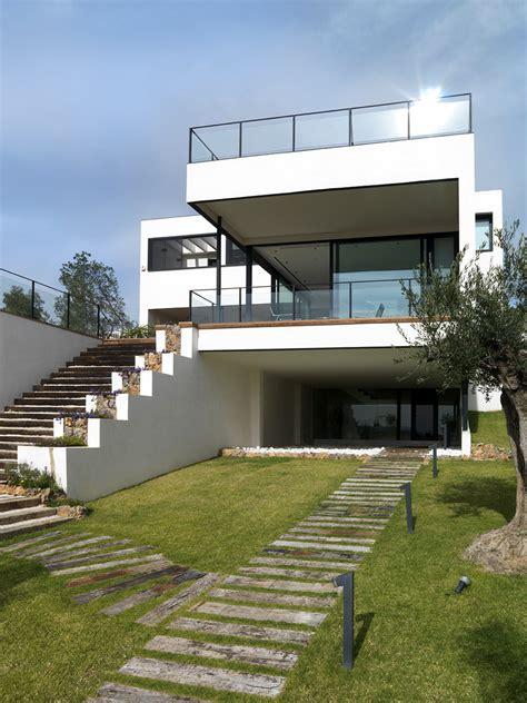 white residence white residence in spain incorporating modern volumes by