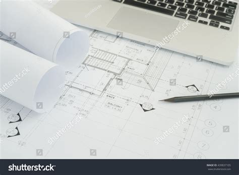 Construction Drawing Paper Black Pencil Computer Laptop On Architectural Stock Photo